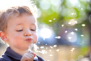 beautiful-blond-kid-blow-dandelion